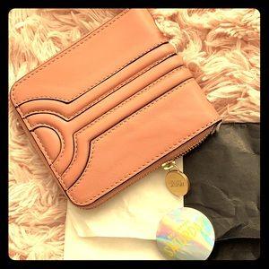 Kate Spade Saturday rose leather zip wallet.